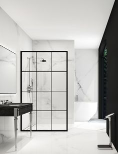 Bathroom Wisdom: Metal Framed Showers. Imitating the on-trend look of the classic Crittall window, metal framed shower screens offer a linear, architectural look for the bathroom. Paired with luxurious marble they give a very high-end finish, but they are equally at home with simple white metro tiles creating a more industrial feel.