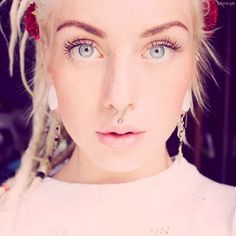 Septum and medusa piercingg <3 I would totally get if I didn't have my nose pierced