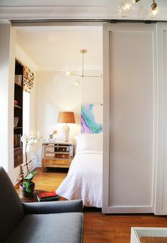 Use floor-to-ceiling pocket doors to give privacy to an alcove bed  ... close for entertaining, open most of the time.