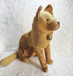 Early Straw Stuffed German Shepherd Dog.  Stuffed animals other than bears are awesome.  Especially ones with the charms that come from being hand made and not mass produced.