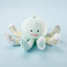 Soc T Pus Plush Toy with 4 Pairs of socks A cute baby shower gift with oceans of warmth & whimsy to baby's tiny toes. Mint green 'Sock T. Pus' plush velour has white polka dots, embroidered black eyes & red smile with 8 legs wearing four pairs of patterned, slip-proof socks.Socks include  solid, argyle & stripes in pale yellow, gray, white & mint-green for Size 0-6 months. Socks are machine-washable cotton-poly blend  with slip-proof bottoms. Velour plush toy is surface-washable  $29.99