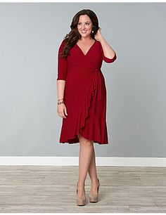 Our Whimsy Wrap Dress is a flirty piece with beautiful cascading flounces along the skirt's front panels and bottom hem. This functional wrap dress is the perfect silhouette for all body types and the extra cinch feature at the waist will only accentuate your fabulous curves even more. The cross-over neckline is great for adjusting the wrap to your preferred coverage and you will love the fitted sleeves with a little extra gathering on the cap for added detail. The Whimsy Wrap Dress will…