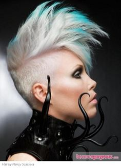 Ultra-Modern Undercut Hair Style with Highlights  Punk Girl Hairstyles pictures     This ultra-modern undercut hair style with highlights is a bold alternative to inject some drama into your look. Blonde hair looks stunning with turquoise hair highlights. Make sure you have the courage to rock a similar crop before taking a plunge into your makeover.