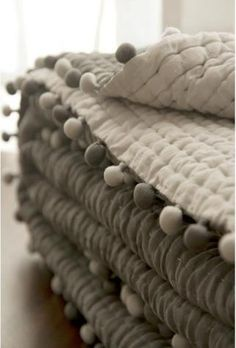 pom pom fringes .. simple french quilting .. grey