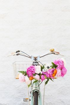 This DIY floral bike basket is the perfect Mother's Day gift for your Mom who doesn't believe in motorized vehicles.