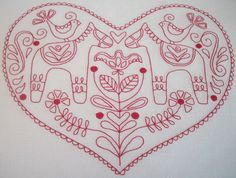 scandinavian rose heart block stitched by christine of auntie's quaint quilts
