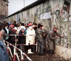 Fall of the Berlin Wall in 1989. A member of the public uses a hammer and chisel to start the collapse of the wall.
