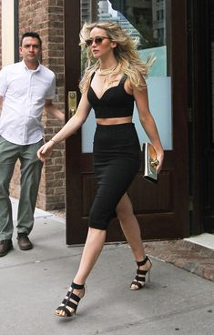 Jennifer Lawrence wears Michael Kors crop top and skirt while out and about in New York on June 28, 2015. Photo: Splash News
