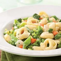 Cheese Tortellini with herbs, fontina broccoli, carrots and snap peas