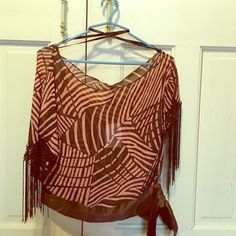 BEBE Fringe kimono Light weight kimono top. Fringe sleeves have open slit at shoulders with silky trim on bottom that ties at the side. Shirt is BRAND NEW and still has original tag. bebe Tops