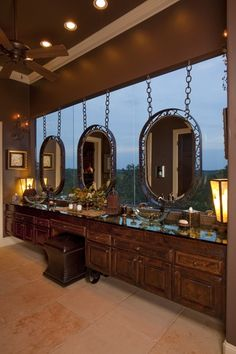 love these hanging mirrors in front of the window!