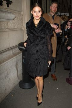 Olivia Palermo layered a plush black coat over a sheer-sleeved blouse while arriving to the Rochas show at Paris Fashion Week.
