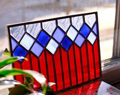 Original handmade stained glass window panel. Made with beautiful shades of light blue, green, and white glass. 12 x 8 All panels can have hooks, loops, or chain added for hanging at no additional cost.
