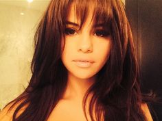 Fringes: Get Inspired By The Best Celebrity Bangs - Selena Gomez With A Voluminous Fringe from InStyle.com