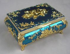 Blue or peach jewelry box with gold detail with roses. Felt lined.