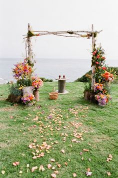 wedding arch or huppah with staggered floral arrangements for interesting height :: photo by michaelandannacosta.com ::  planning by soigneproductions.com :: floral by triciafountaine.com   Read More: http://stylemepretty.com/2013/03/26/santa-barbara-wedding-at-dos-pueblos-ranch-from-michael-anna-costa/