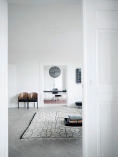 (BrandonRugs.com) The use of #handmade #rugs in these adjacent rooms is comforting. It's like knowing that after encountering the shock of the new, you can still feel grounded with something warm and fuzzy.