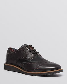 $124, Toms Brogued Leather Wingtip Oxfords. Sold by Bloomingdale's. Click for more info: https://lookastic.com/men/shop_items/167950/redirect