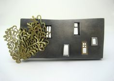 """Lauren E. Wethers """"behind the tenements"""" brooch 5x13cm (gold and oxidised silver)"""