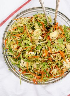 Crisp and delicious Brussels sprout slaw with almonds, carrots, sesame seeds and bold honey-soy dressing. This simple, healthy slaw is perfect for potlucks.