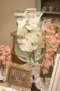 Put fake flowers in large vases and then fill them with water. So easy and pretty!