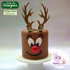 Eat, drink and be merry this Christmas with this cheeky reindeer cake!  Created by design team member Sarah of The Cupcake Range. Holiday Cakes, Holiday Decor, Christmas Cakes, Reindeer Cakes, 7th Birthday Cakes, Planter Pots, Chocolate, Christmas Ornaments, Create