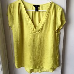H&M Blouse Pretty flowy bright yellow blouse with a v-neck. Like new. Only worn briefly a couple times. H&M Tops Blouses