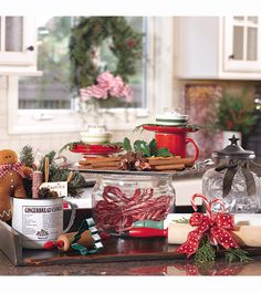 Like the tray (holding cinnamon sticks and votive candles in teacups on top of coffee cups) on top of a glass container filled with candy canes. Wish You Merry Christmas, Christmas Time Is Here, Simple Christmas, All Things Christmas, Christmas Holidays, Christmas Kitchen, Country Christmas, Christmas Inspiration, Christmas Ideas