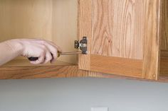 Remove the cabinet doors and drawers from the frames, and remove the hardware