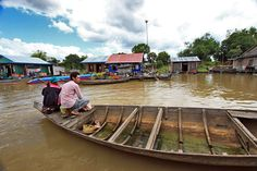 Floating Houses on Tonle Sap River During Boat Ride from Battambang to Siem Reap, Cambodia