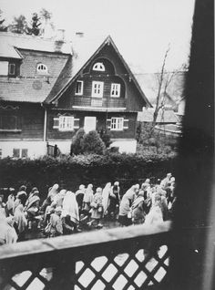 Death march prisoners from Dachau sub-camp Wolfratshausen-Getling pass through a German town. The photo was shot by some heroic soul standing in the second floor window of a private house, 1945.
