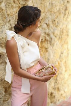 Gorgeous one shoulder bow blouse with blush trousers & a rose gold clutch with a sleek up do for date night or a dressier affair.
