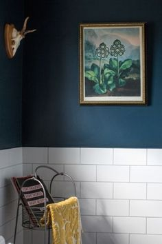 The bathroom is a split between Farrow & Ball Hague Blue and white tiles from Tiles at a Click. The painting came from the Dublin Flea Market. Eclectic and fun bathroom. Hague Blue Bathroom, White Bathroom Tiles, Yellow Bathrooms, Bathroom Kids, White Tiles, Wall Tiles, Yellow Tile, Concrete Bathroom, Shower Tiles