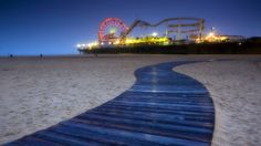 A warm night, the cool sand and the joyful noise of the pier in the distance.  I could live here...