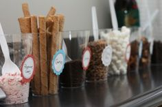 Hot chocolate bar... white, dark and sweet homemade hot chocolate + cognac + peppermint & cinnamon sticks and a variety of other goodies and spices...
