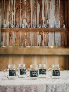chalkboard mason jars with table numbers http://www.weddingchicks.com/2013/11/20/cozy-country-wedding/