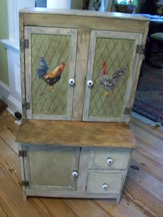 Vintage childs step-back kitchen cabinet  found in bad shape in a barn.  Re-envisioned in primitive look with Roosters adding French Country flair.