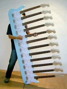 12 Neck Guitar - This is a real photo!  Check Seymour Duncan's F.B. page if you don't believe me. I'm curious to see what the case looks like! (72 strings! Constantly tuning it)