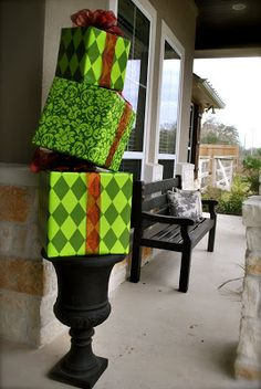 Christmas gifts stacked on a topiary! Need empty boxes, wrapping paper, bows and rebar to keep it stacked.