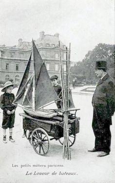 https://flic.kr/p/5WfvZh | 1906 photo of vendor with model sailboats for rent at Jardin de Luxembourg Paris France