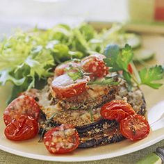 Top stacks of oven-fried eggplant with fresh tomato sauce and mozzarella and Parmesan cheeses to make a satisfying summertime vegetarian dinner.