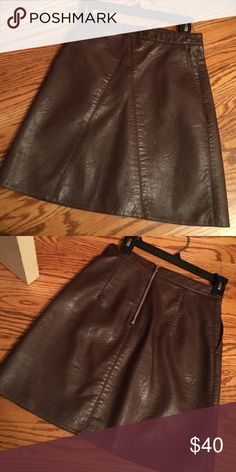 Zara skirt Looks like a very appealing brown color. (When I bought it I first thought it was burgundy). Fitted skirt, pockets on the side, really nice leather material, not a tacky cheap material. Beautiful on Zara Skirts Mini