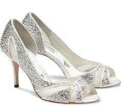 A shoe fit for a princess, open waisted peep toe adorned with beautiful crystals with delicate mesh detailing.