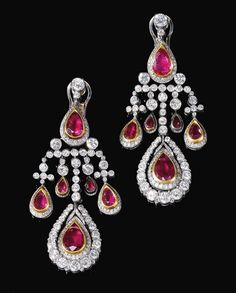 AIR OF RUBY AND DIAMOND PENDENT EARRINGS, 1970S  PROPERTY FROM THE ESTATE OF DONNA SIMONETTA COLONNA, DUCHESSA DI CESARÒ  Each of chandelier design, suspending pear-shaped drops collet-set with a rubies,