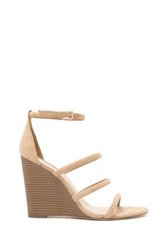 A pair of faux suede wedges in a strappy design with a faux wood sole and a buckled ankle strap. #stepitup