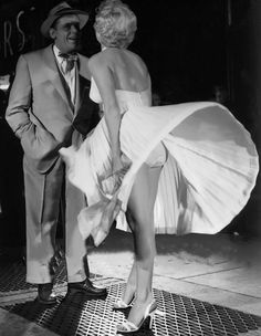 """Tom Ewell and Marilyn on the set of """"The Seven Year Itch"""", 1954."""
