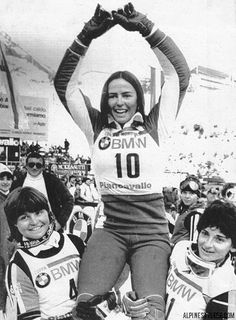 PIANCAVALLO, ITALY: Fabienne Serrat, of France, winner of the World Cup slalom raises her hands as she is held by Erike Hess (L) of Switzerland who finished second and Maria Rosa Quario of Italy who came in third. Alpe D Huez, Ski Racing, Ski Posters, Alpine Skiing, Vintage Ski, Winter Games, Sports Stars, Press Photo, Held