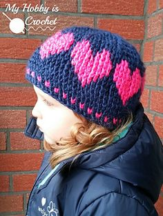 This cute crochet hat with hearts going around is made using a new version of Fair Isle Crochet, replacing the traditional single crochet stitches with front post double crochet stitches.