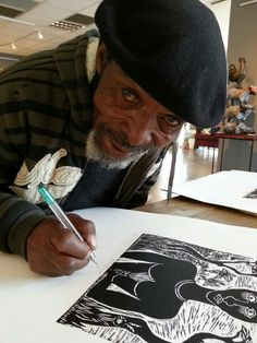 David Phoshoko signs his new edition of ARTEYE LTD EDITION woodcuts.