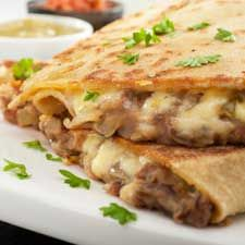 THIS LOOKS DELICIOUS! This bean and cheese quesadilla recipe is a great meal when you are in a hurry. Bean and Cheese Quesadilla Recipe from Grandmothers Kitchen.